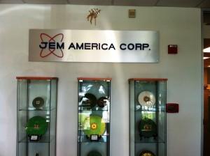 Dimensional logo on brushed aluminum panel - JEM America