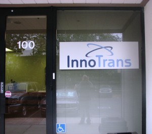 Custom brushed aluminum sign with digital graphics on clear media