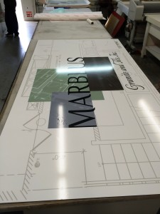 Aluminum panel sign with full color graphics in production