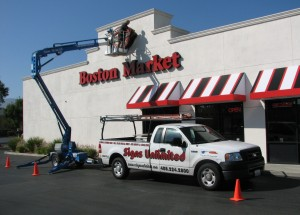 Installing new Boston Market Logo Signs